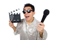 Young man with microphone and clapperboard Royalty Free Stock Photos