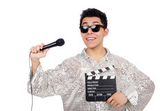 Young man with microphone and clapperboard Stock Photo