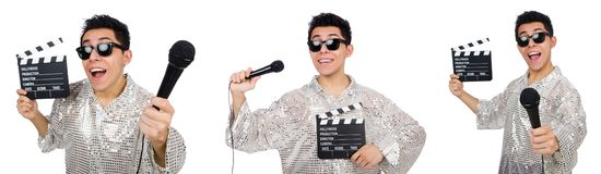 The young man with microphone and clapperboard isolated on white. Young man with microphone and clapperboard isolated on white royalty free stock image