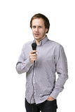 Young man with microphone Royalty Free Stock Photo