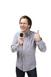 Young man with microphone Royalty Free Stock Photography