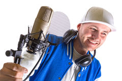 Young man with microphone in the studio Stock Image