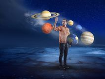 Young man in middle of solar system Stock Image