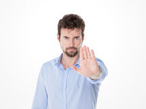 Young man with miking stop with his hand Stock Photos