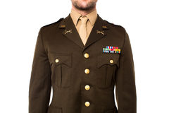 Young man in military uniform, cropped image Royalty Free Stock Images