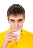 Young Man with a Milk. Young Man drink a Milk Isolated on the White Background Stock Image