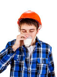 Young Man with a Milk. Young Man in Hard Hat drink a Milk Isolated on the White Background Royalty Free Stock Image