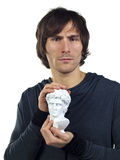Young man mimicks the Roman bust in his hands Stock Images
