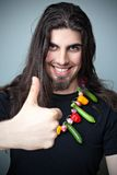 Young man with miniature vegetables Stock Photo
