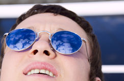 Young man with mirror glasses Royalty Free Stock Image
