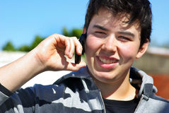 Young man and mobil phone. Stock Images