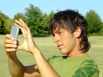 Young man with mobile Stock Photography