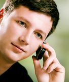 Young man with mobile phone. Outdoors Stock Photo
