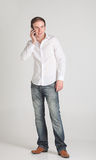 Young man with mobile phone Royalty Free Stock Images
