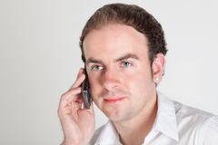 Young man with mobile phone Stock Photo
