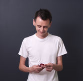 Young man with mobile phone. Royalty Free Stock Images