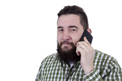Young man with mobile phone Stock Images