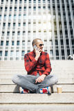 Young man with mobile phone in the city. Royalty Free Stock Photos