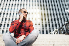 Young man with mobile phone in the city. Stock Photos