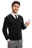 Young man with a mobile phone Stock Photography