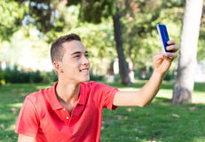 Young man with mobile phone. Outdoor Royalty Free Stock Photography