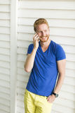 Young man with mobile phone outdoor. Handsome young man with mobile phone outdoor Stock Photos