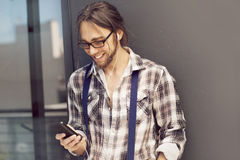 Young man with mobile phone. Sending text message Royalty Free Stock Images