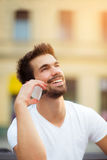Young man with mobile phone. On the street Stock Photography