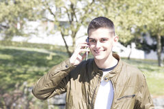 Young man with mobile phone. On street Stock Photography