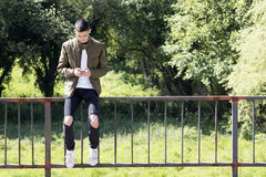 Young man with mobile phone. On street Royalty Free Stock Photos
