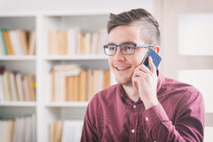 Young man with mobile phone Stock Photography