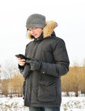 Young man with mobile phone Royalty Free Stock Photos