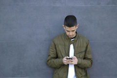 Young man with mobile phone. On street Royalty Free Stock Images
