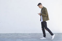 Young man with mobile phone. On street Royalty Free Stock Photography