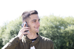 Young man with mobile phone. On street Stock Image
