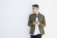 Young man with mobile phone. On street Stock Images