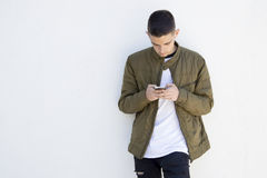 Young man with mobile phone. On street Stock Photo