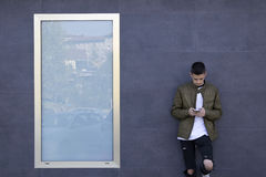 Young man with mobile phone. On street Stock Photos