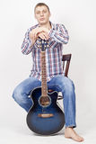 Young man model with guitar over white Royalty Free Stock Photo