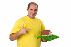 Young man with model house Stock Image