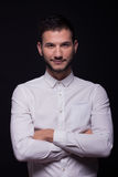 Young man model posing, white shirt smiling Royalty Free Stock Photography