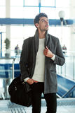 Young man in modern airport Stock Photos
