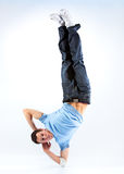 Young man modern dance. Bright white and blue background stock photo