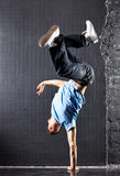 Young man modern dance. On dark wall background royalty free stock photography