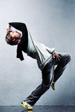Young man modern dance. On wall background royalty free stock images