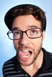 Young man modern nerd wide angle portrait blue royalty free stock images