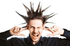 The guy plugged ears. A young man with a Mohawk on his head covers his ears Stock Photography
