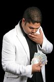Young Man with Money. Handsome young man with worried look holding money Royalty Free Stock Photos