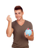 Young man with a money box Stock Photography