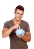 Young man with a money box Royalty Free Stock Photos